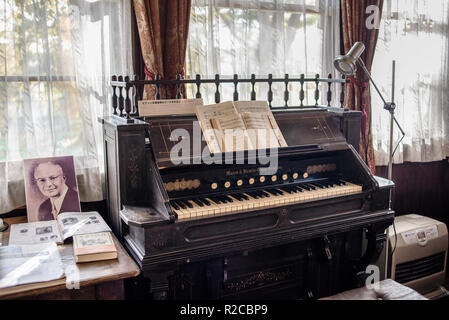 The Hokkaido's oldest organ is displayed in the house of Mr. and Mrs. Pierson who were devoted to preach Christianity in the Kitami area. The organ, made by the American company Mason and Hamlin, in 1878, is the very instrument that was played by Mrs Pierson during church services. It is still used at concerts held in this house.  Pierson Memorial House, Kitami, Hokkaido, Japan. - Stock Image