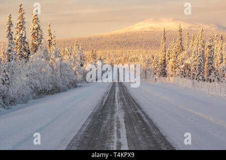 Landscape in winter season, nice warm afternoon light, ice road leading in to the picture, mountain in background, Gällivare county, Swedish Lapland,  - Stock Image