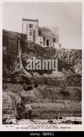 Coastal erosion, Black Rock, Brighton, Sussex, with tourists standing on the ledge. - Stock Image