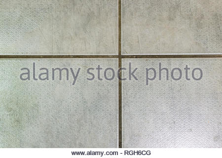 Close up of square gray tiles background. - Stock Image