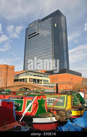 narrow boats moored in Gas Street Basin and the Hyatt Hotel, Birmingham, West Midlands, England, UK - Stock Image