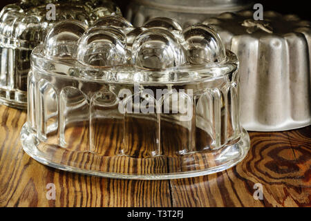 Old fashioned glass and aluminum jelly or blancmange moulds for making traditional jellies - Stock Image