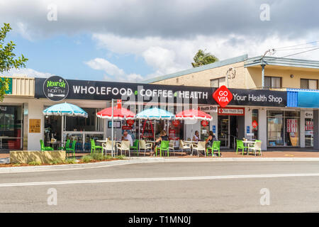 Batemans Bay, Australia - 12th February 2018: People drinking coffee in the sunshine. Cafe culture is popular in Australia. - Stock Image