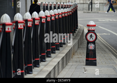 Pedestrian bollards on the side of the road - Stock Image
