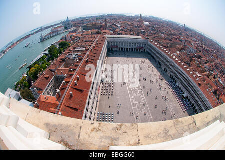 Fish eye lens view from St Marks Bell Tower Venice Italy showing Piazza San Marco St Marks Square and left the Grand - Stock Image