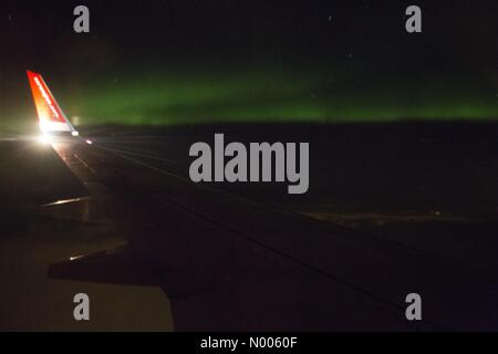 Norway. 10th February, 2016. Weather: Northern light photographed from a Norwegian airplane on its way from Oslo - Stock Image