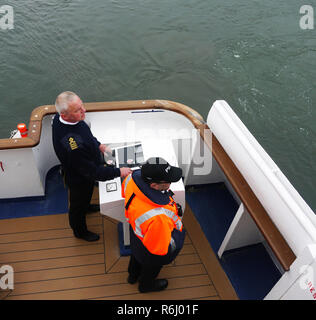 Pilot on board ship leaving Aberdeen harbour Scotland with Captain at the wheel - Stock Image