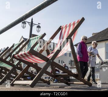 Sidmouth, 1st Apr 19 With the arrival of April, deckchairs are once more out along the seafront at Sidmouth in Devon on a glorious springtime day. Credit: Photo Central/Alamy Live News - Stock Image
