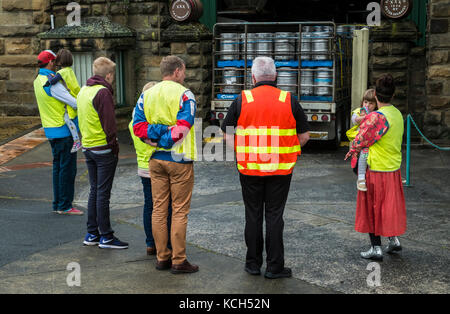 A family in high visibility yellow begins a tour of the Cascade Brewery in South Hobart, Tasmania. The guide is - Stock Image