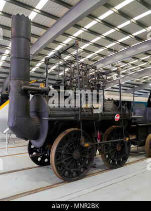 Replica of Locomotion No.1 a very early steam engine original built 1825 shown in National Railway Museum Shildon - Stock Image