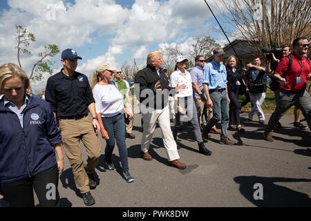 Panama City, Florida, USA. 15th Oct 2018. U.S President Donald Trump during a tour of damage in the aftermath of Hurricane Michael October 15, 2018 in Lynn Haven, Florida. Standing with the president from left to right are: Homeland Security Secretary Kirstjen Nielsen, FEMA Administrator Brock Long, First Lady of Florida Ann Scott President Donald Trump, First Lady Melania Trump and Florida Gov. Rick Scott. Credit: Planetpix/Alamy Live News - Stock Image