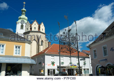 View in the city of Neunkirchen, showing the Maria Himmelfahrt church, in the Austrian state of Lower Austria. - Stock Image