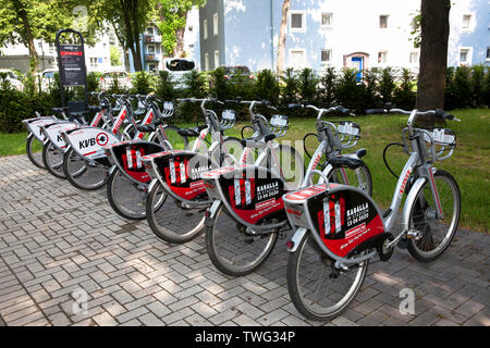 rental e-bikes at a charging station at the Stegerwald housing estate in the district Muelheim, climate-protection housing estate, Cologne, Germany. - Stock Image