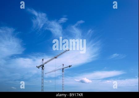 Cranes against blue sky - Stock Image
