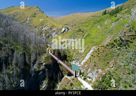 Historic Skippers Suspension Bridge (1901), Skippers Canyon, Queenstown, South Island, New Zealand - aerial - Stock Image