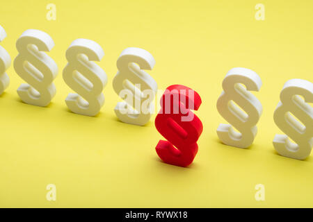 Close-up Of Red Paragraph Symbol Leading Others On White Background - Stock Image