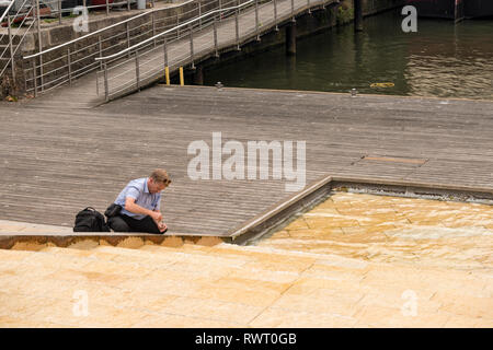 Environment Agency officer takes water sample from Cascade Steps, Bristol, UK - Stock Image