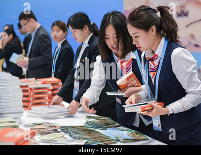 (190423) -- BEIJING, April 23, 2019 (Xinhua) -- Staff members prepare materials to be displayed at the Cultural Exhibition Area of the Media Center for the second Belt and Road Forum for International Cooperation in Beijing, capital of China, on April 23, 2019. The media center started trial operation at the China National Convention Center in Beijing Tuesday. More than 4,100 journalists, including 1,600 from overseas, have registered to cover the second Belt and Road Forum for International Cooperation to be held from April 25 to 27 in Beijing. (Xinhua/Li He) - Stock Image