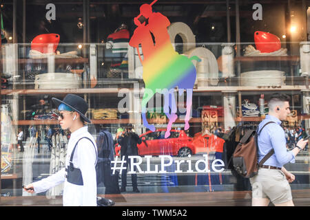 London, UK. 21st June, 2019. Pedestrians in Regent street walks past a Ralph Lauren logo decorated in rainbow colours in preparation for the annual Pride celebration and LGBT equality and tolerance Credit: amer ghazzal/Alamy Live News - Stock Image