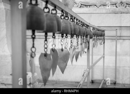 prayer bells in buddhist temple with depth of field - Stock Image