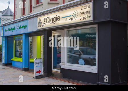 14 December 2018 A small E Ciggie Vaping Outlet in Newcastle County Down Northern Ireland on a dull midwinter day leading up to Christmas - Stock Image