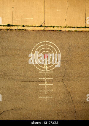 Pole aerial High Dynamic Range (HDR) image of a playground game painted on pavement. Includes target, numbers, circles - Stock Image