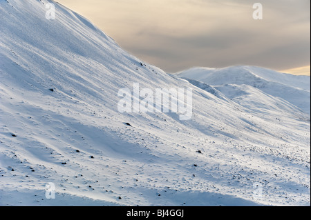 image of snow covered mountains at glenshee scotland - Stock Image