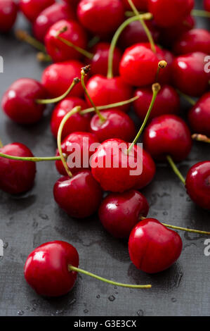 Rinsed fresh cherries background close up. - Stock Image