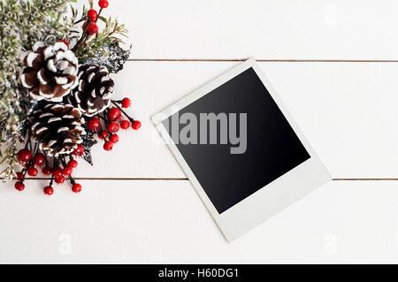Blank photo frames and Christmas decor - Stock Image