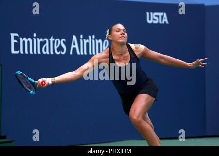 New York, United States. 02nd Sep, 2018. Flushing Meadows, New York - September 2, 2018: US Open Tennis: Kala Kanepi of Estonia reaches for a forehand to Serena Williams during their fourth round match at the US Open in Flushing Meadows, New York. Williams won in three sets. Credit: Adam Stoltman/Alamy Live News - Stock Image