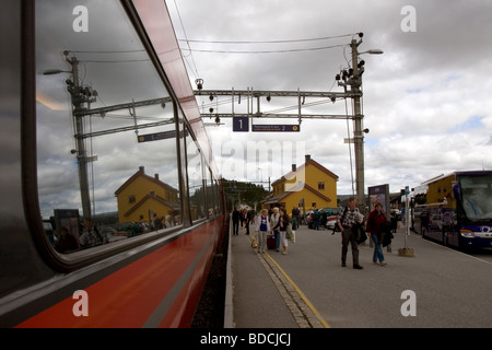 Platform and station building reflected at Geilo train station, Geilo, Buskerud, Norway - Stock Image