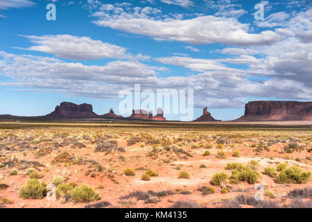Monument Valley red sand region on the Arizona-Utah border, USA. Navajo Tribal Park and used for a location for - Stock Image
