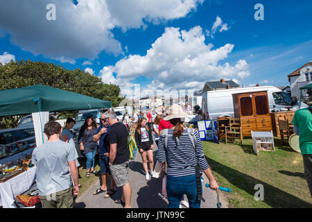 Busy crowds on a hot sunny summer's day at a big outdoor antiques fair in popular upmarket Southwold, Suffolk, UK - Stock Image