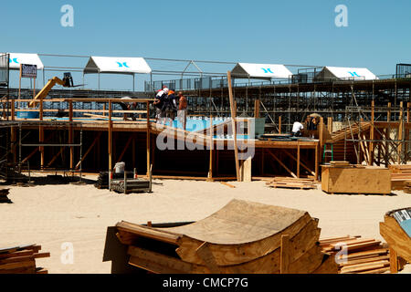 July 19th 2012  Construction crews work on erecting the stands, stadiums  and bleachers south of Huntington Beach - Stock Image