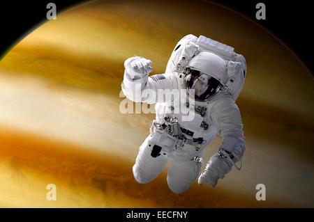 Artist's concept of an astronaut floating in space above a large, alien planet. - Stock Image