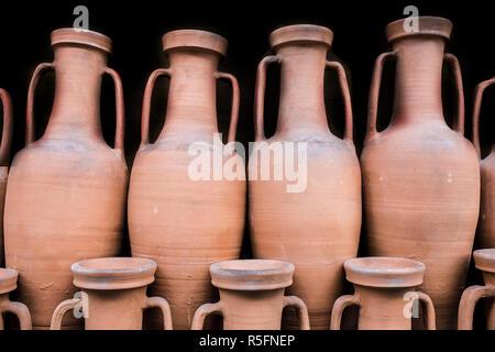 Ancient roman amphorae stored at hold ship as ancient times trade. Isolated over black - Stock Image
