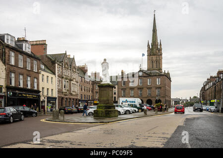 A view of the High Street in Montrose, Scotland looking towards Old and St Andrews Church and the monument to Joseph Hume. - Stock Image