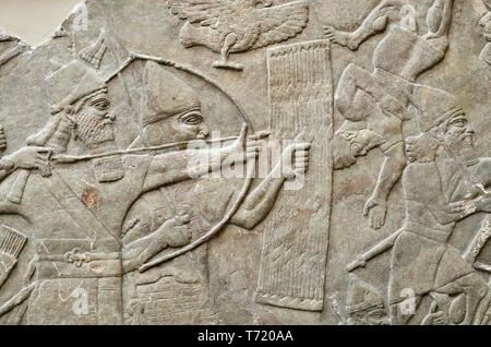 British Museum, Bloomsbury, London, England, UK. Panel from the Assyrian Palace at Nimrud, 865-860 BC. Battle scene - Stock Image