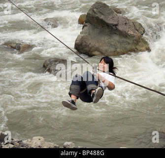 Crossing the Pitiao River, Wolong on a zip wire - Stock Image