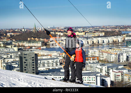 Mother and son in a ski lift - Stock Image