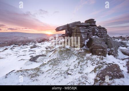 Winter snow on Belstone tor at sunrise, Dartmoor National Park Devon uk - Stock Image