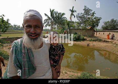 BANGLADESH Farmer with fish pond, Kumargati village, Mymensingh region photo by Sean Sprague - Stock Image