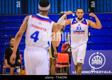 London, UK, 20th April 2019. Royals' Will Ohuaregbe (21) flexes his muscles after a point. Tensions run high in the London City Royals v Glasgow Rocks BBL Championship game at Crystal Palace Sports Centre. Home team LCR win the tight game 78-70. Credit: Imageplotter/Alamy Live News - Stock Image