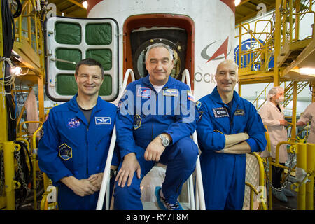 International Space Station Expedition 59 backup crew members Drew Morgan of NASA (left), Alexander Skvortsov of Roscosmos (center) and Luca Parmitano of the European Space Agency (right) pose for pictures in front of the Soyuz MS-12 spacecraft during final inspection at the Baikonur Cosmodrome March 10, 2019 in Baikonur, Kazakhstan. Expedition 59 crew: Christina Koch of NASA, Alexey Ovchinin of Roscosmos, and Nick Hague of NASA will launch March 14th onboard the Soyuz MS-12 spacecraft for a six-and-a-half month mission on the International Space Station. - Stock Image