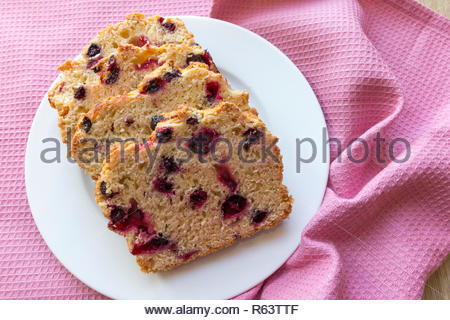 Slices of blackcurrant tea bread on a plate - Stock Image