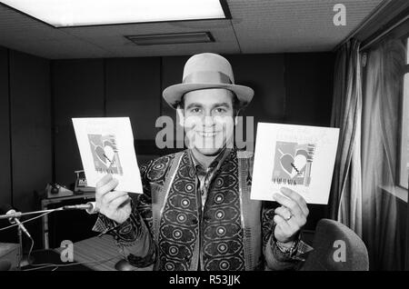 Elton John at BRMB Radio Aston, Birmingham. The visit was to promote his latest single, 'Breaking Hearts (Ain't What It Used To Be)' and to also chat to his fans in the Midlands. 22nd February 1985. - Stock Image