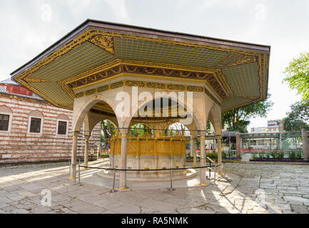 The ablution fountain outside of the Hagia Sophia museum on a Spring day, Istanbul, Turkey - Stock Image
