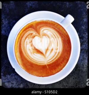 Coffee with love heart in a white cup and saucer - Stock Image
