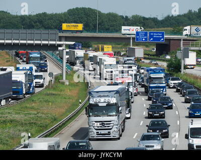 German Autobahn motorway expressway highway traffic Jam truck lorry container bottleneck congestion CO2 emissions - Stock Image