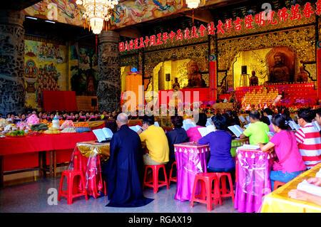 People praying inside Kek Lok Si, Air Itam, Penang, Malaysia - Stock Image